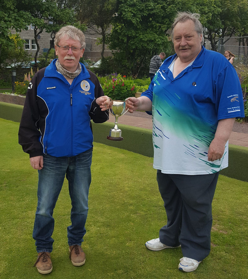 Alex Elphinstone presented with the Mundie Midsummer Cup by the club president Ewen MacRitchie