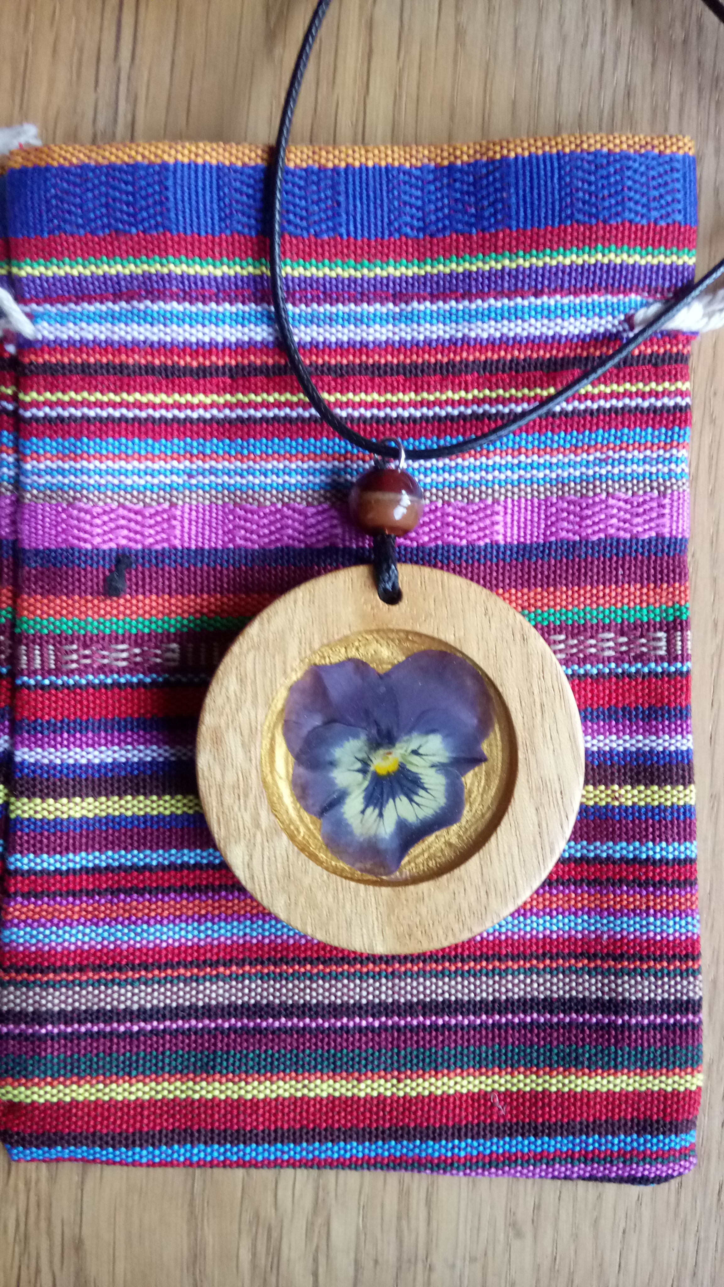 Wooden pendant with real flower