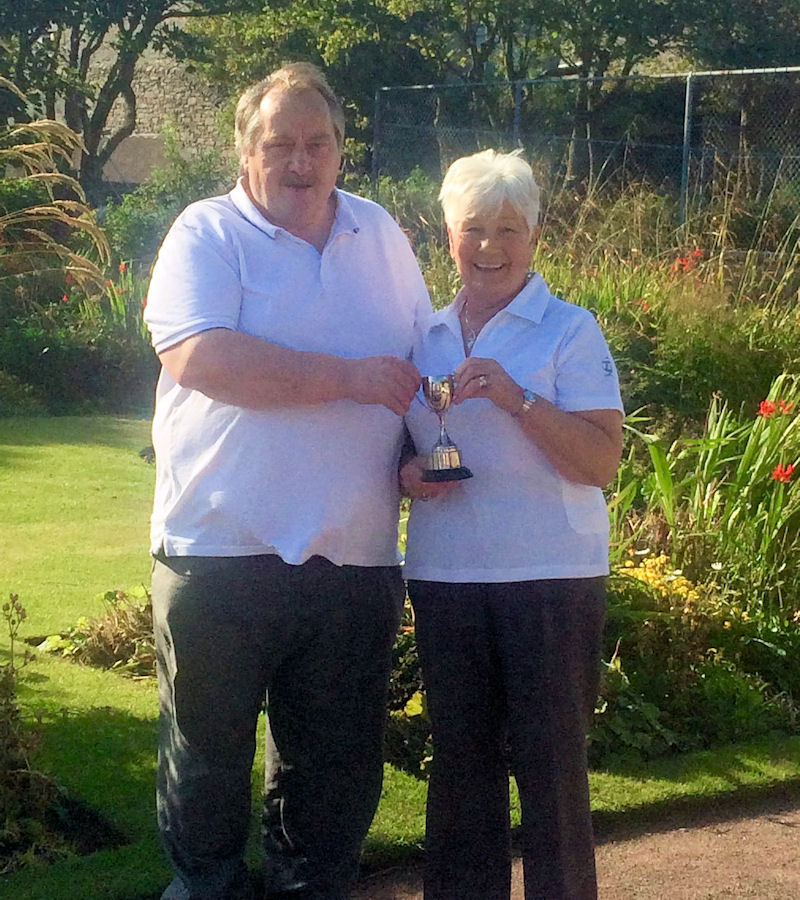 Joan Nicolson presenting British Legion trophy to Ewen MacRitchie.