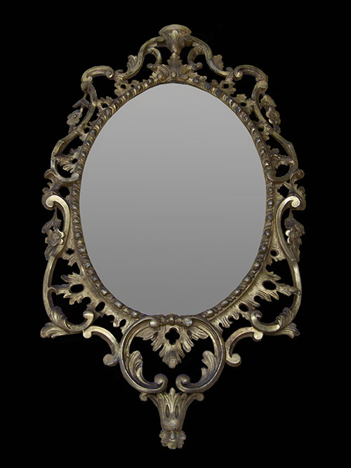 carved wood oval mirror