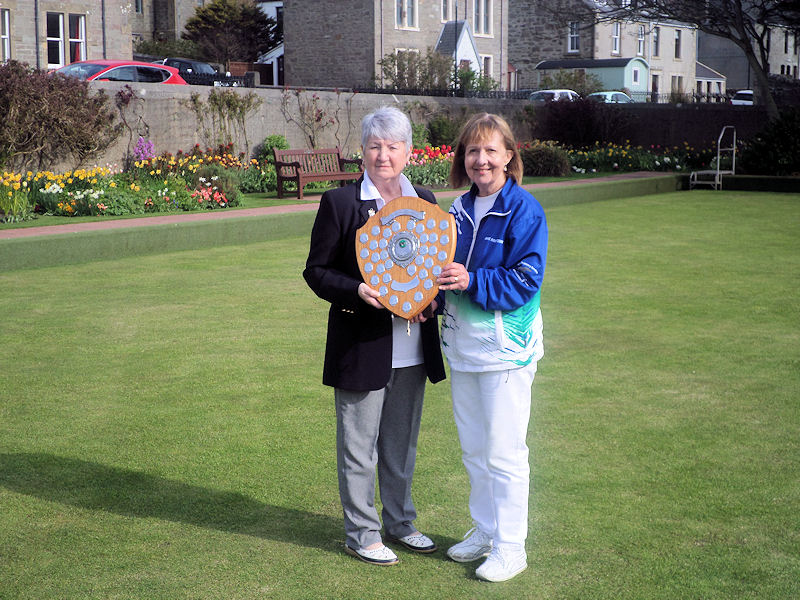 The attached photo shows Anne Robertson (on the right) being presented with the Robbie Watt Shield by the club President Elma Scott