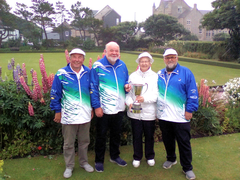 Billy Hay, Bob Brandie, Margaret Johnson and Alan Smith with the Robertson Memorial Trophy
