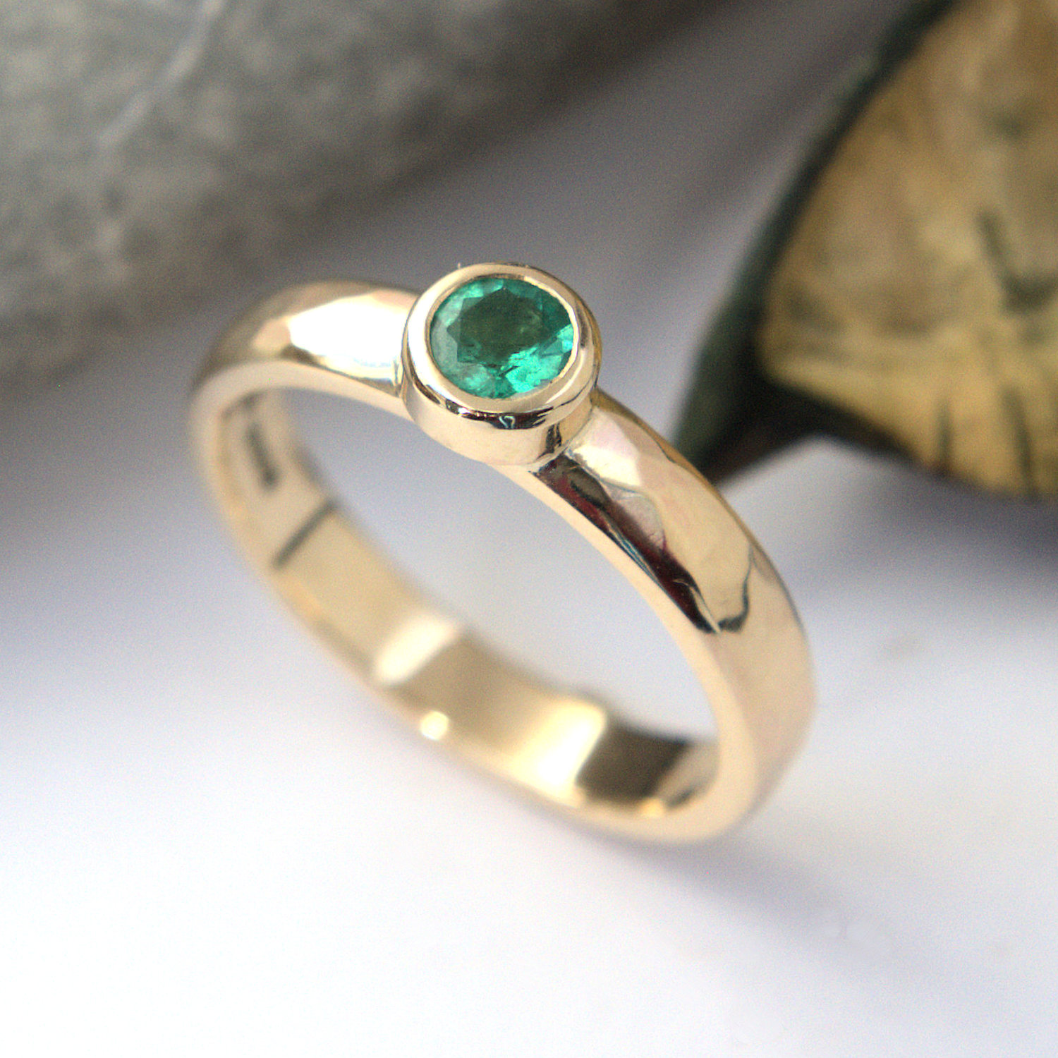 Emerald 9ct gold planished ring