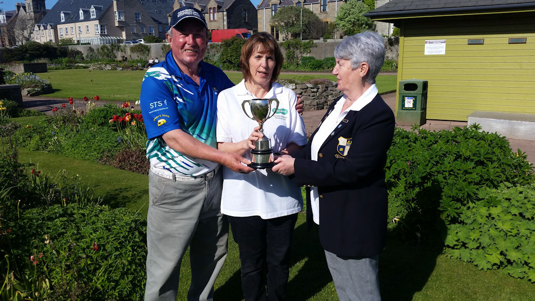 Angela Gifford and Billy Hay being presented with the George Wilson Trophy.