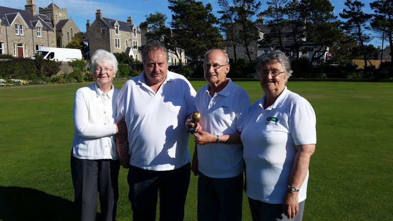 The photo shows (left to right) Margaret Johnson, Ewen MacRitchie presenting the Crown Green trophy, Ian Scott and Eleanor Black
