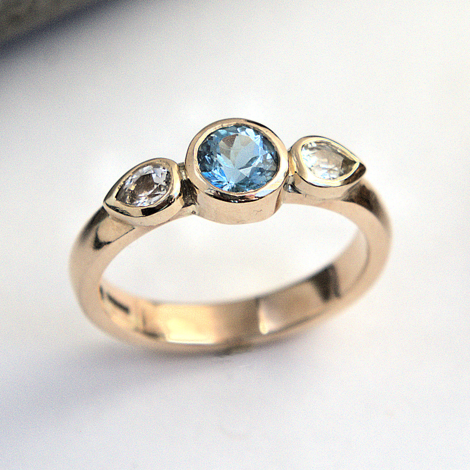 Aquamarine and white sapphire ring