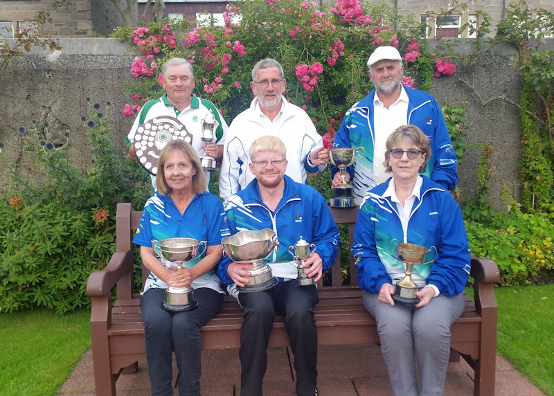 Trophy winners Tam Terris, John Jarmson and Alan Smith, Anne Robertson, Scott Hurst and Carline Smith.