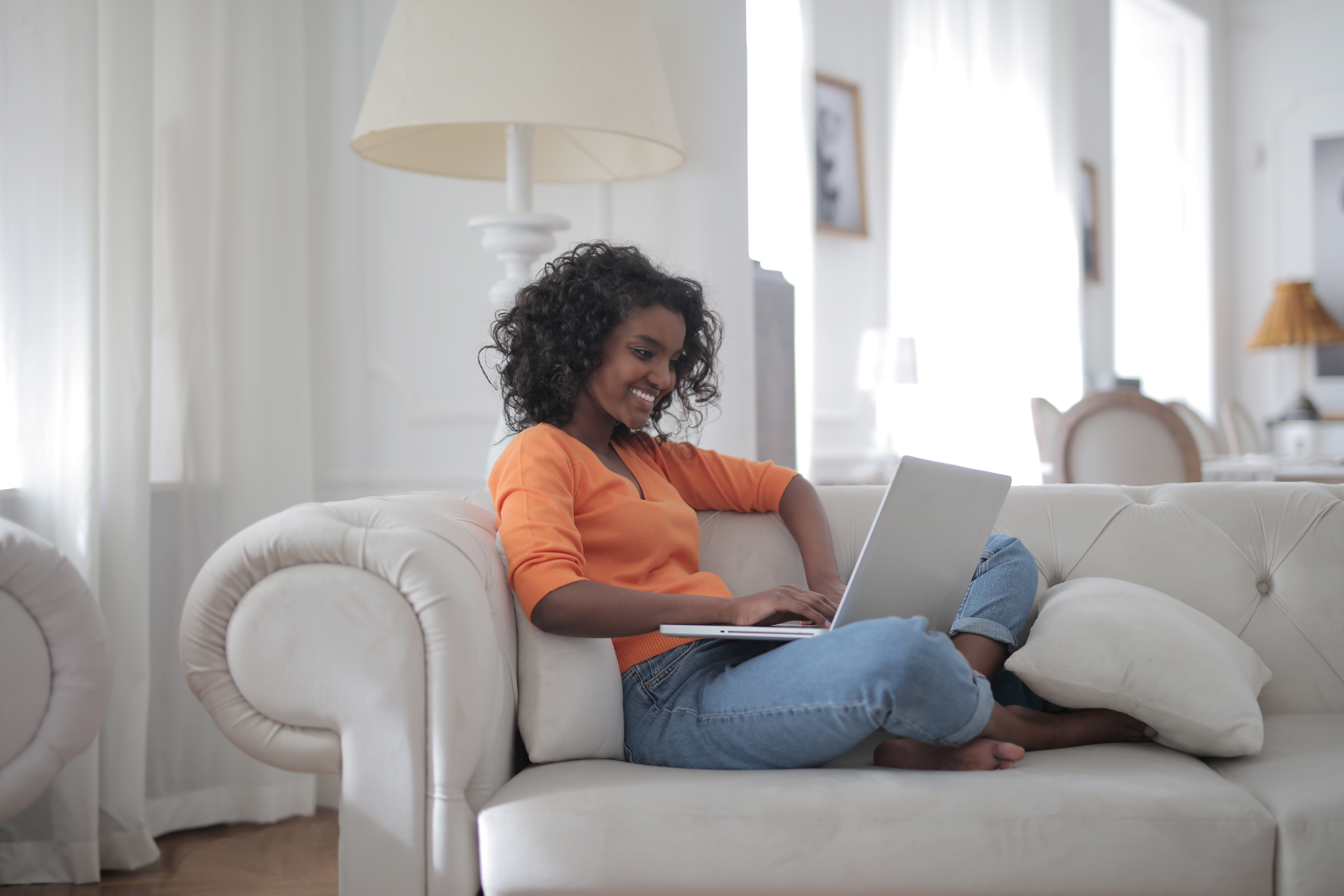 woman-sitting-on-white-couch-using-laptop-computer-3960127.jpg