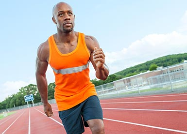 african american man running on a track