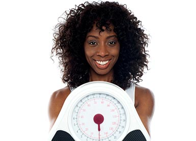 african american woman holding a scale