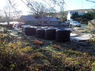 Lorry tyres and pallets are the primary products for the construction of a base for our yurt