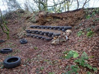 Using reclaimed tyres, here is the midway stages of building a seating and retaining wall
