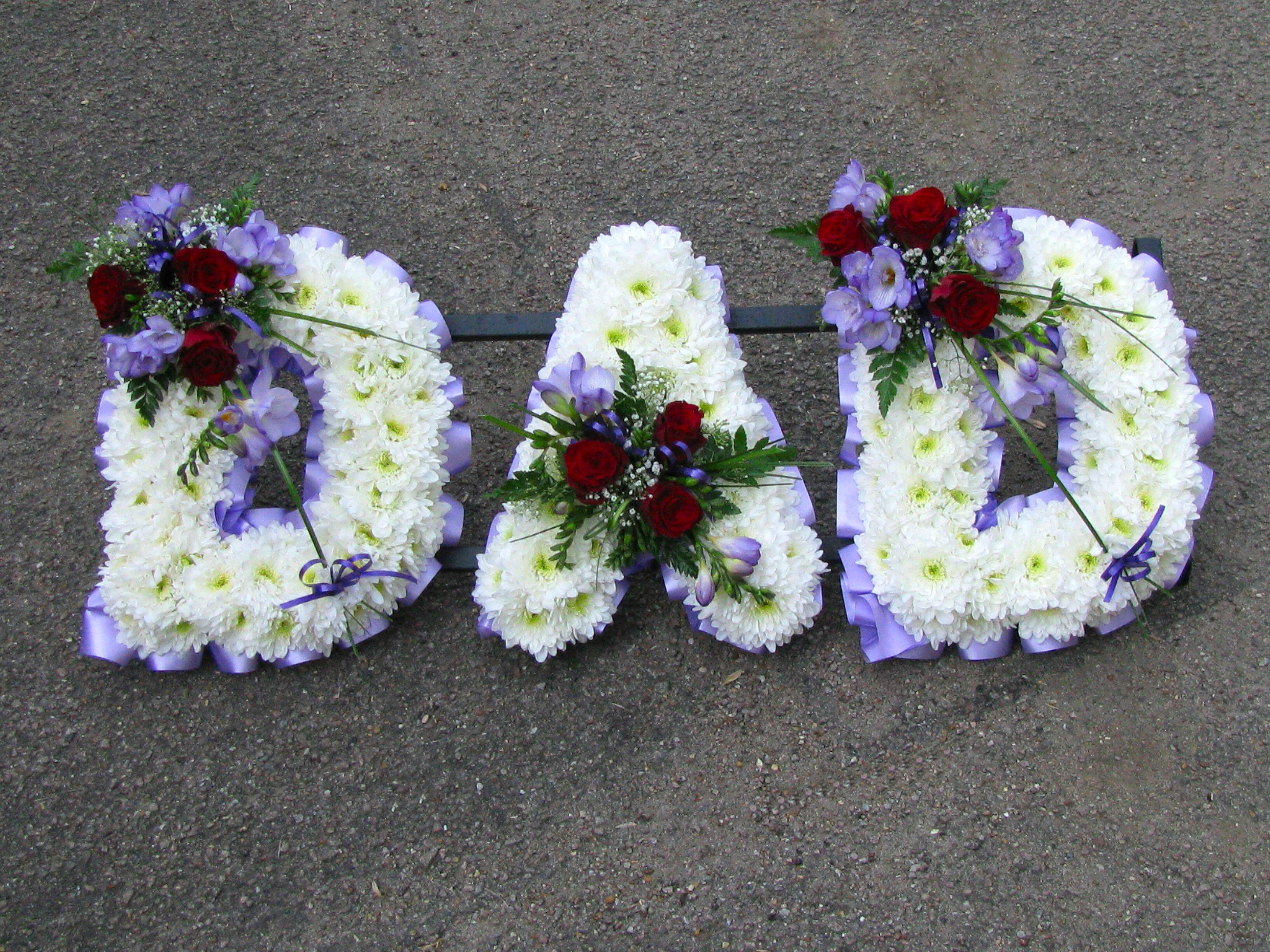 Family funeral tribute names funeral names tribute names funeral names 23 dad in white with lilac ribbon edge lilac freesias and red roses izmirmasajfo Image collections