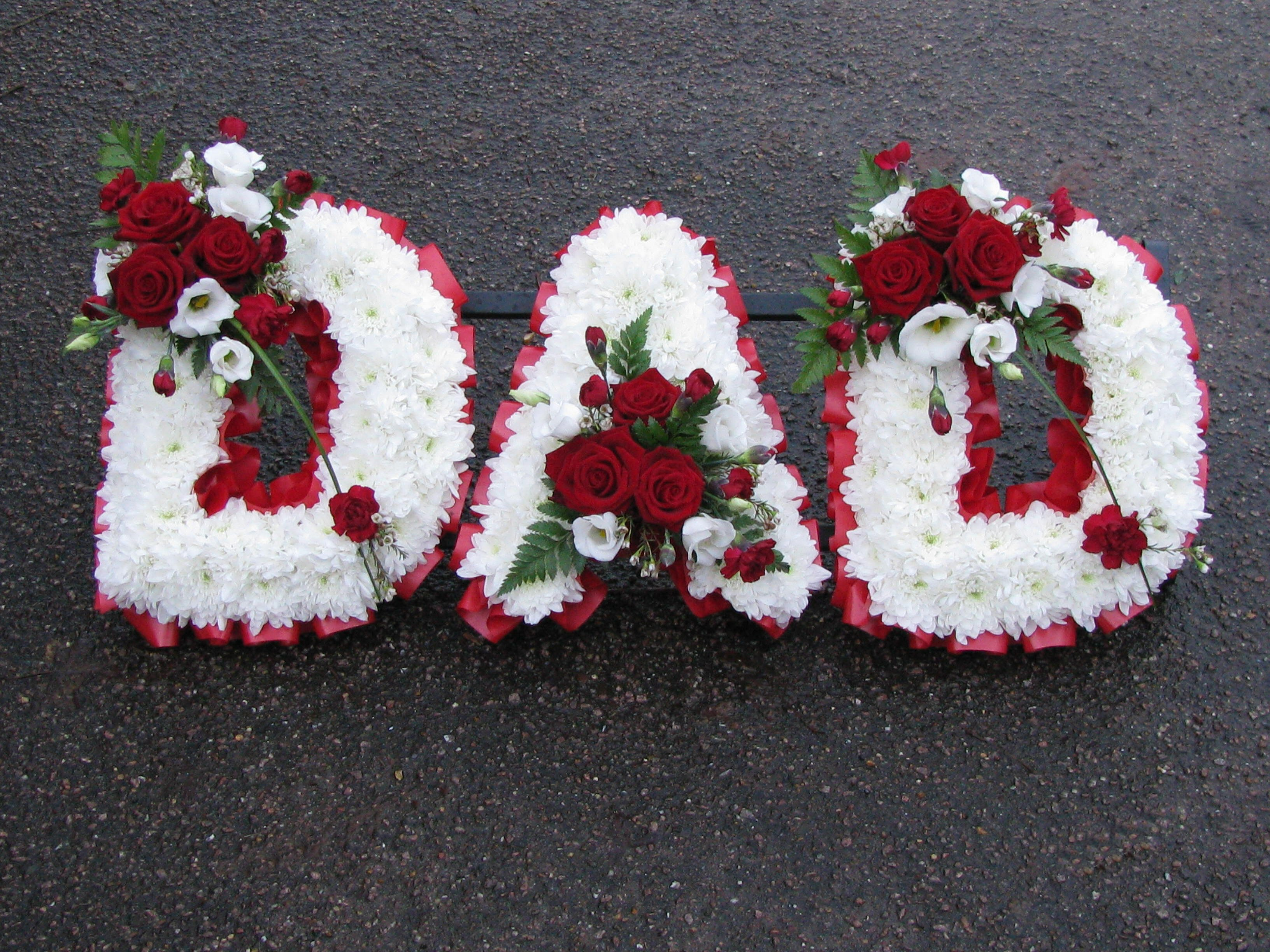 Family funeral tribute names funeral names tribute names funeral names 15 dad in white with red ribbon edge and posys of red roses dianthus and white lisianthus izmirmasajfo Image collections