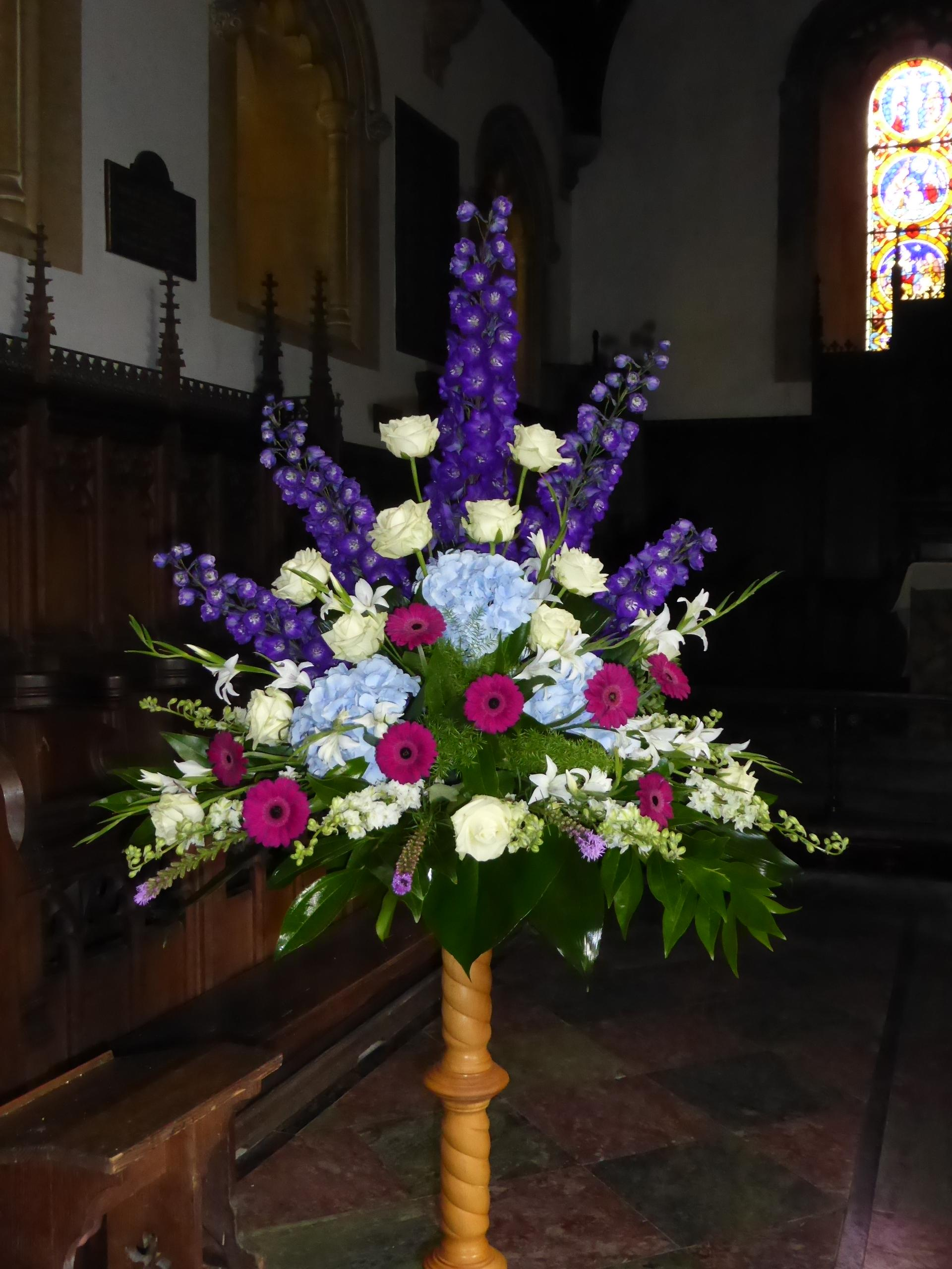 Wedding church flowers beautiful large pedestal with grand prix roses