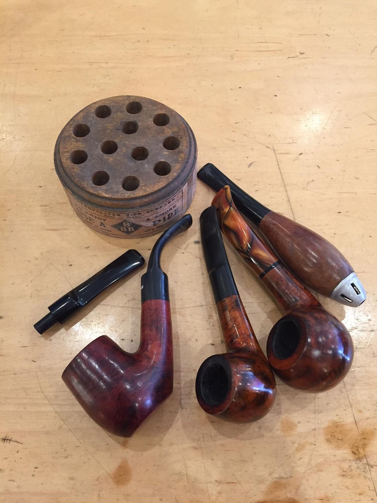 Selection of smoking pipes and cleaning block