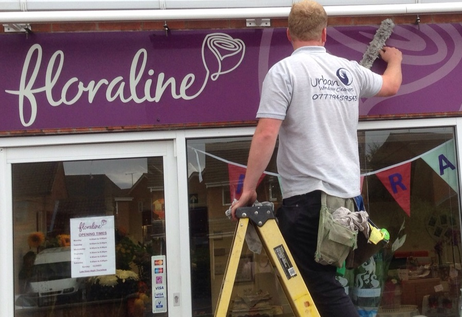 Shop front sign cleaning