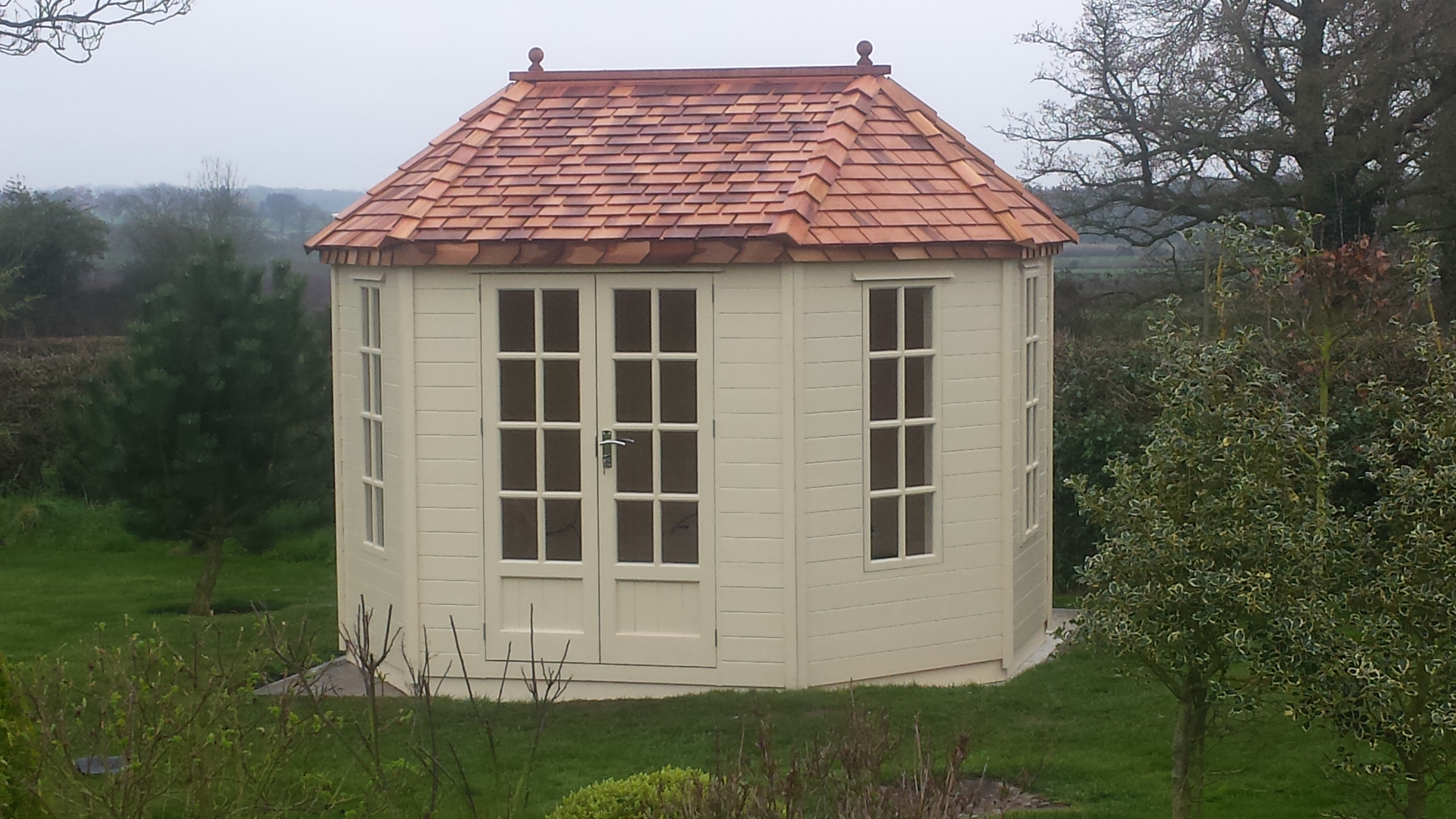 CEDAR ROOF SUMMERHOUSE