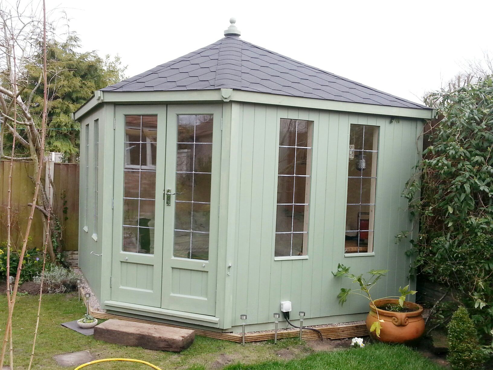 pale green corner summerhouse