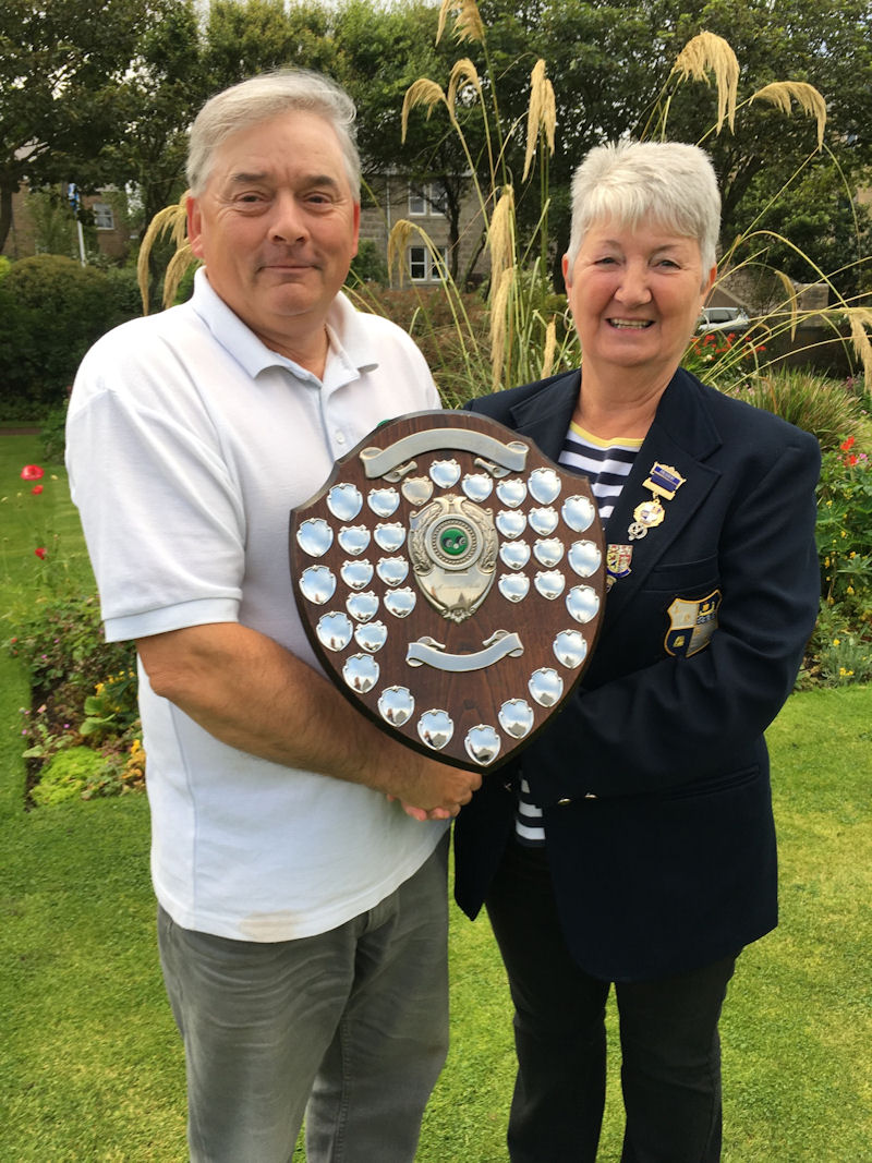 Elma Scott, the club's vice-President awarding the Veterans Shield to Tam Terris