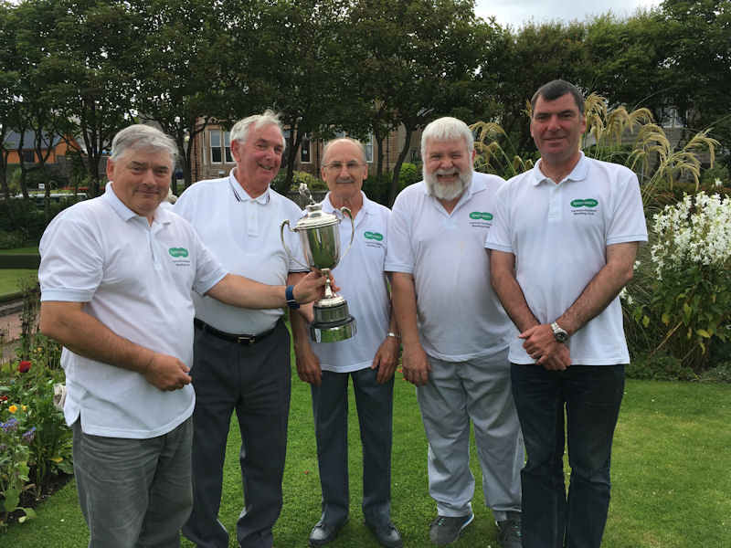 Tam Terris (left) presenting the trophy to Gordon Stevenson, Ian Scott, Sandy Stewart and Donald Campbell