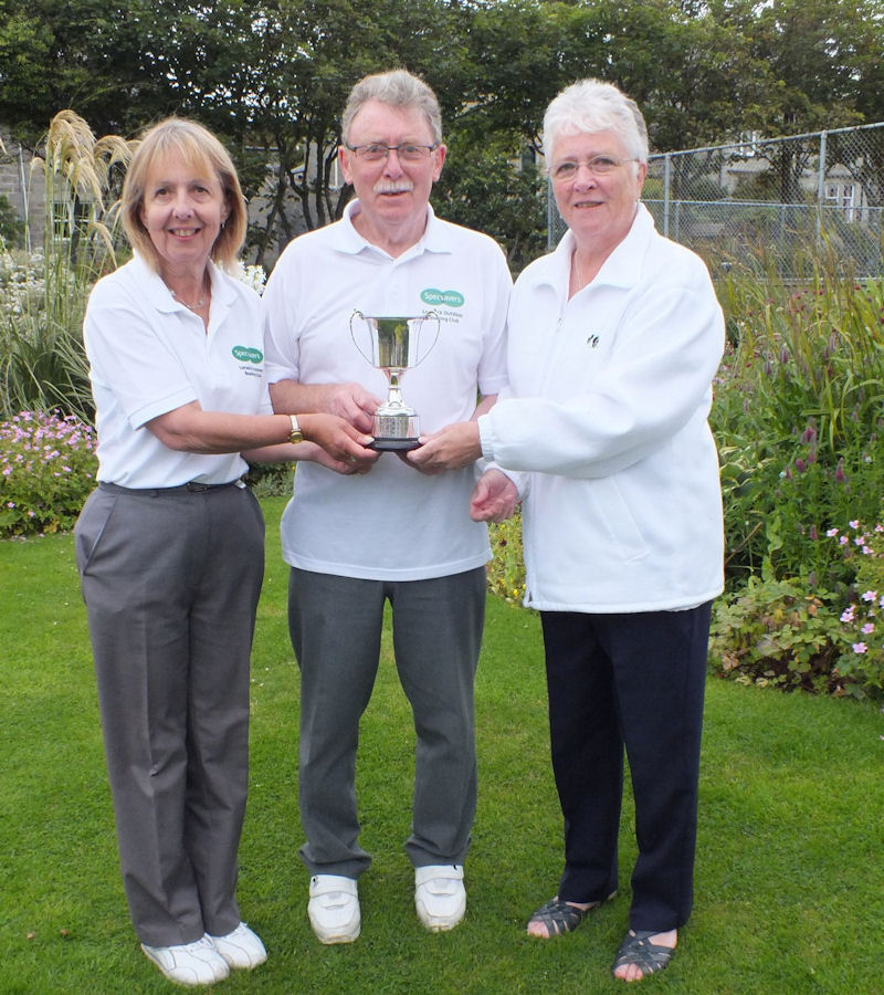 Jean Jarmson (right) presents the cup to Anne Robertston and Alex Elphinstone