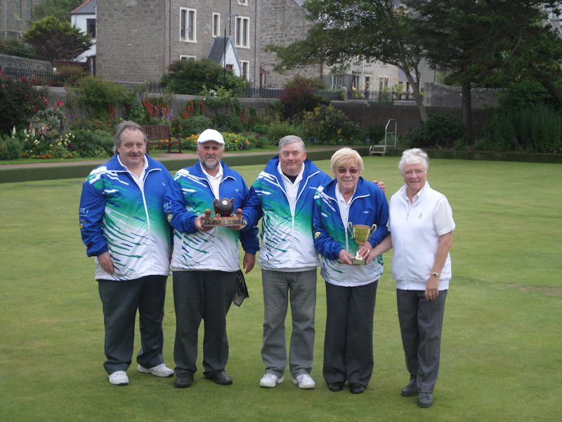 Both sets of trophy winners with Ewen MacRitchie and Alan Smith (left) and Madge Fotheringham and Jean Jarmson (right). In the centre is the club President Tam Terris