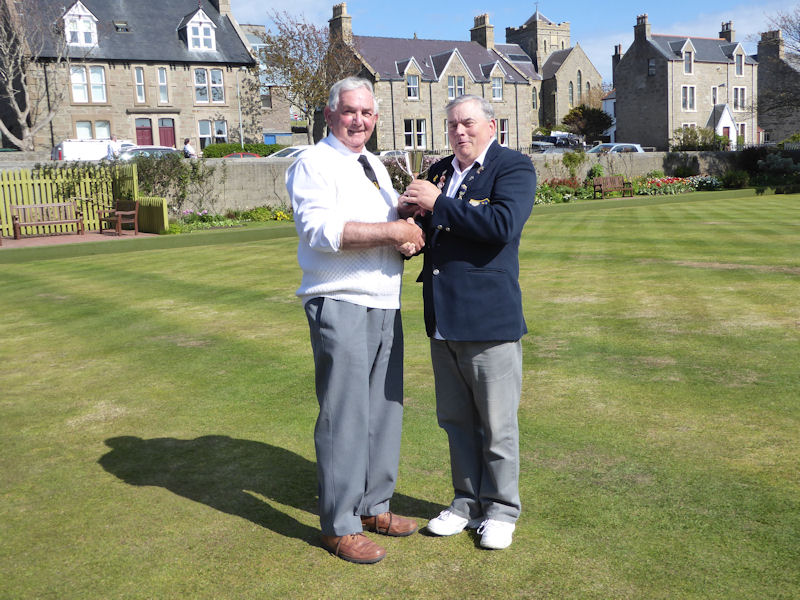 Gordon Stevenson presenting the trophy to the bowling club President Tam Terris