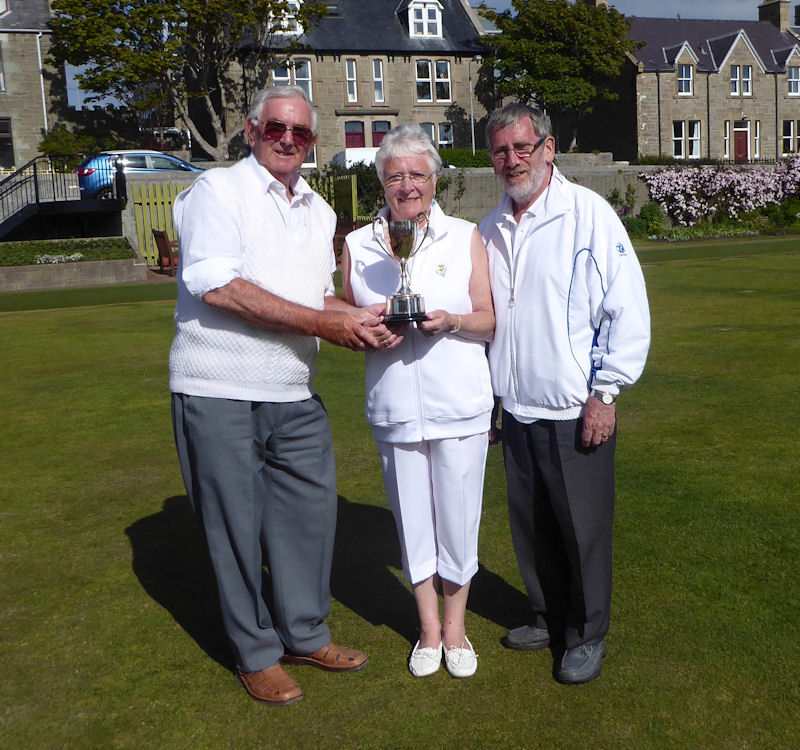Gordon Stevenson presenting the  Morton Lodge Open Pairs Trophy to the winners Jean and John Jarmson