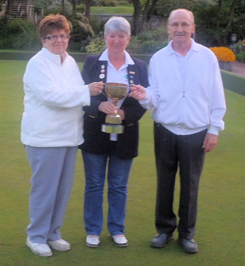 Anne Barron and Ian Scott being presented with Greens final trophy
