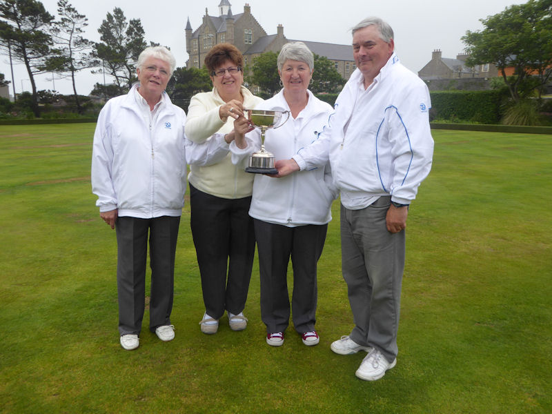 President, Tam Terris presenting the trophy to Jean Jarmson, Anne Barron and Elma Scott.