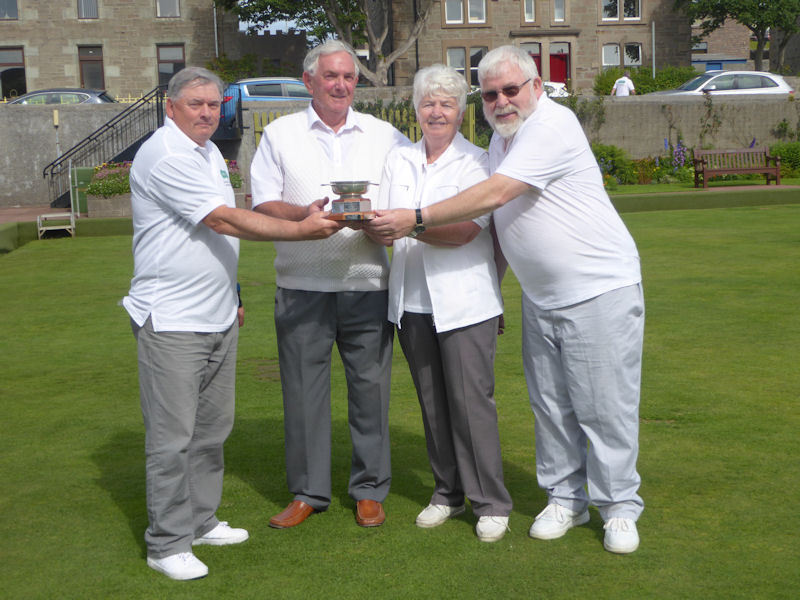 Tam Terris (left) presenting the trophy to Gordon Stevenson, Babs Mundie and Sandy Stewart