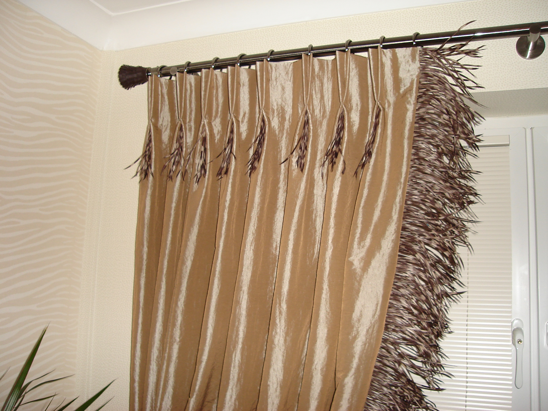 caramel silk pinch pleat curtains with feather trim