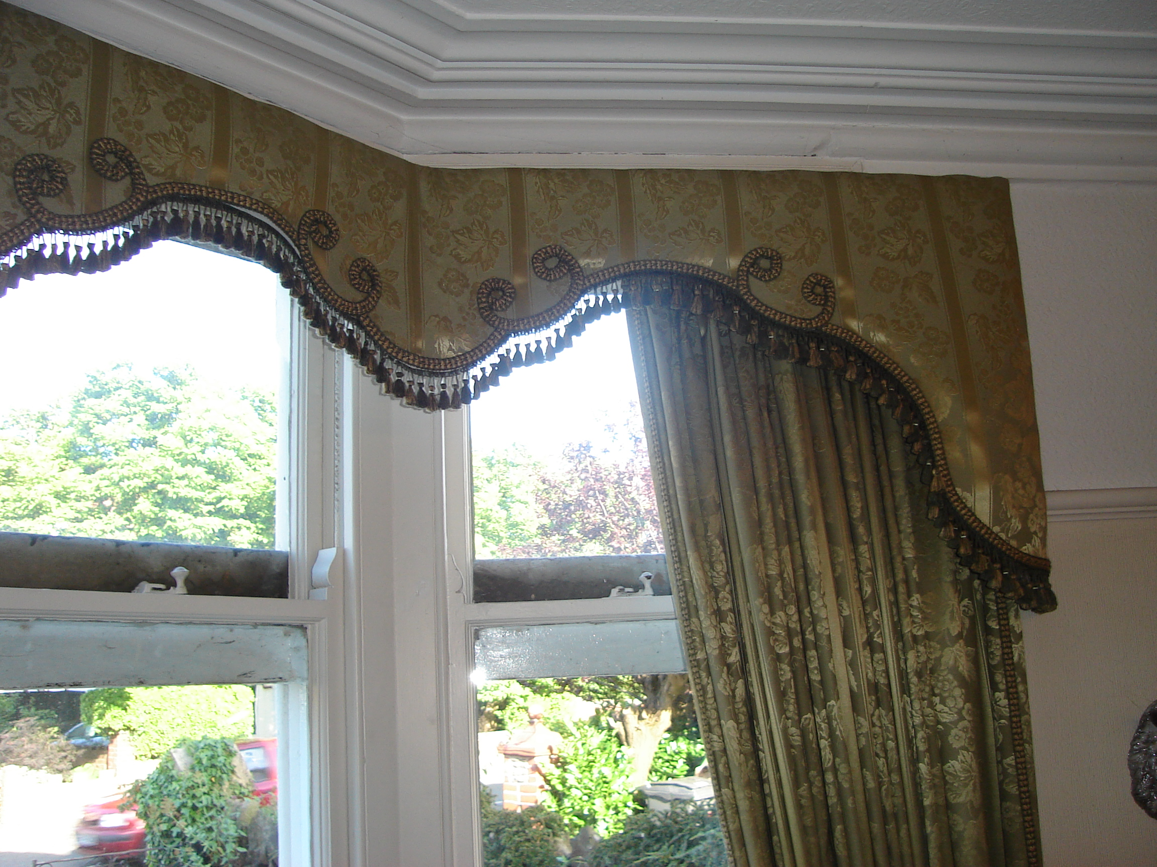 ornate olive green pelmet and curtains with braid trim