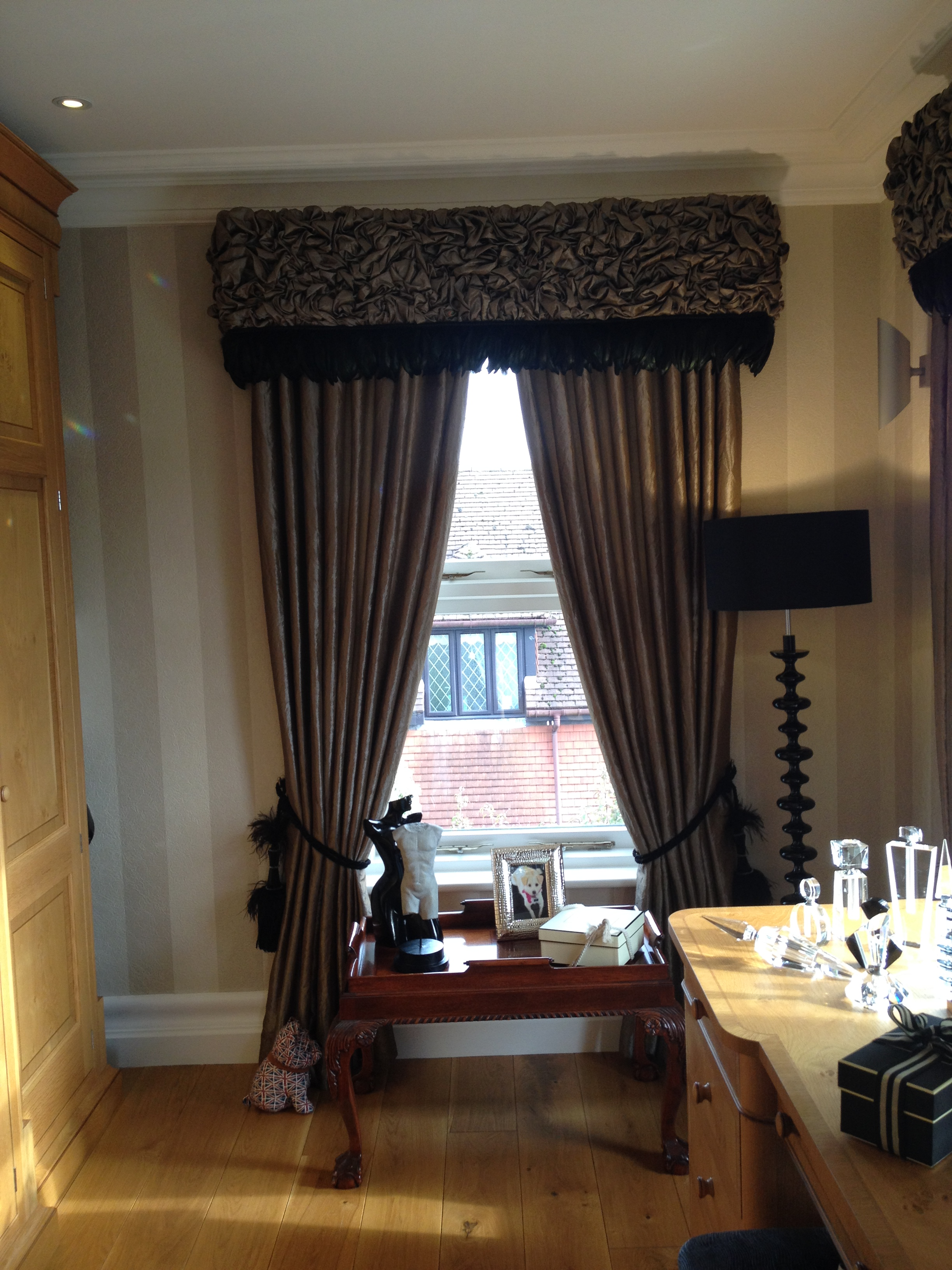 ruched pelmets with feather trim and matching curtains