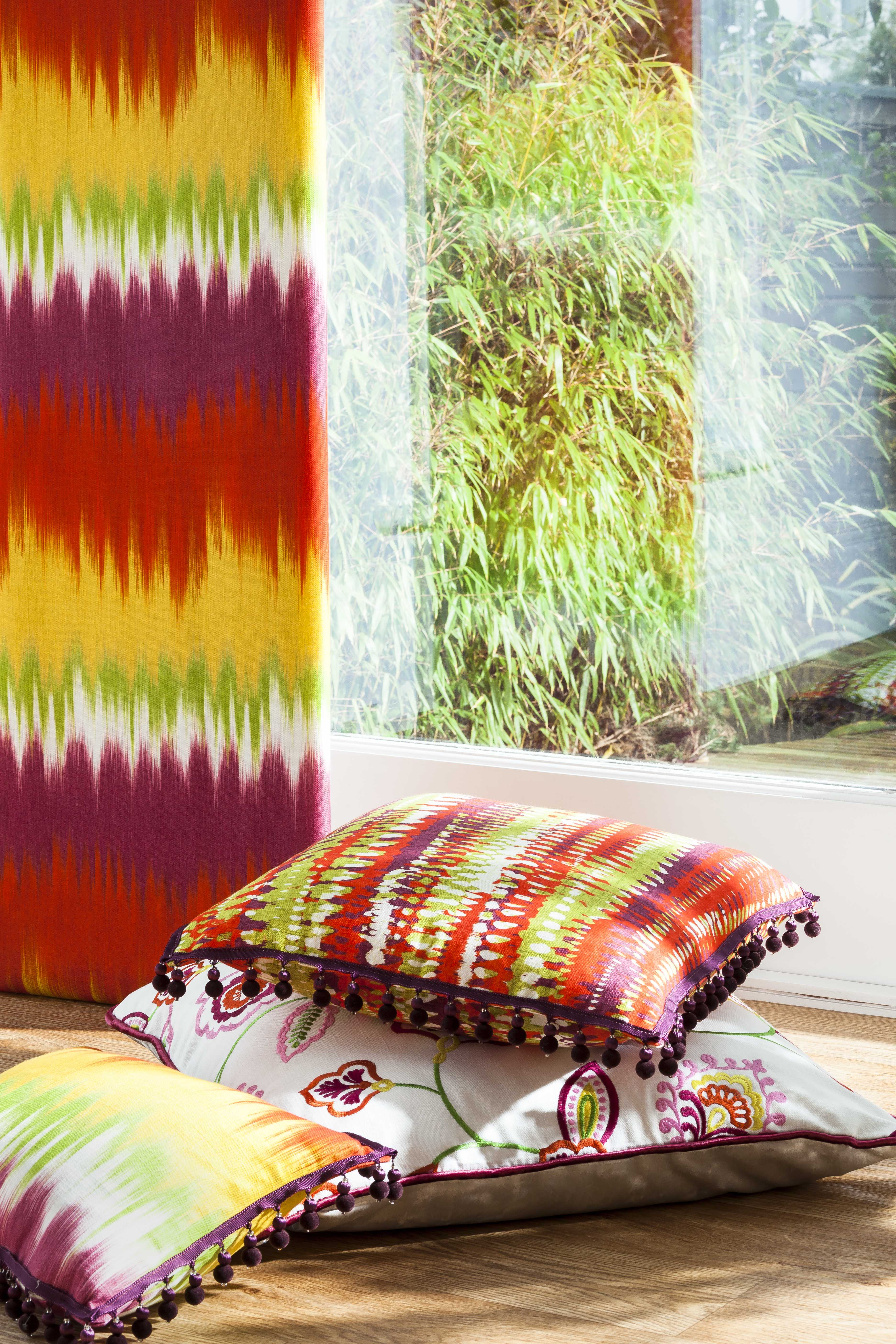 brightly coloured fabric and cushions