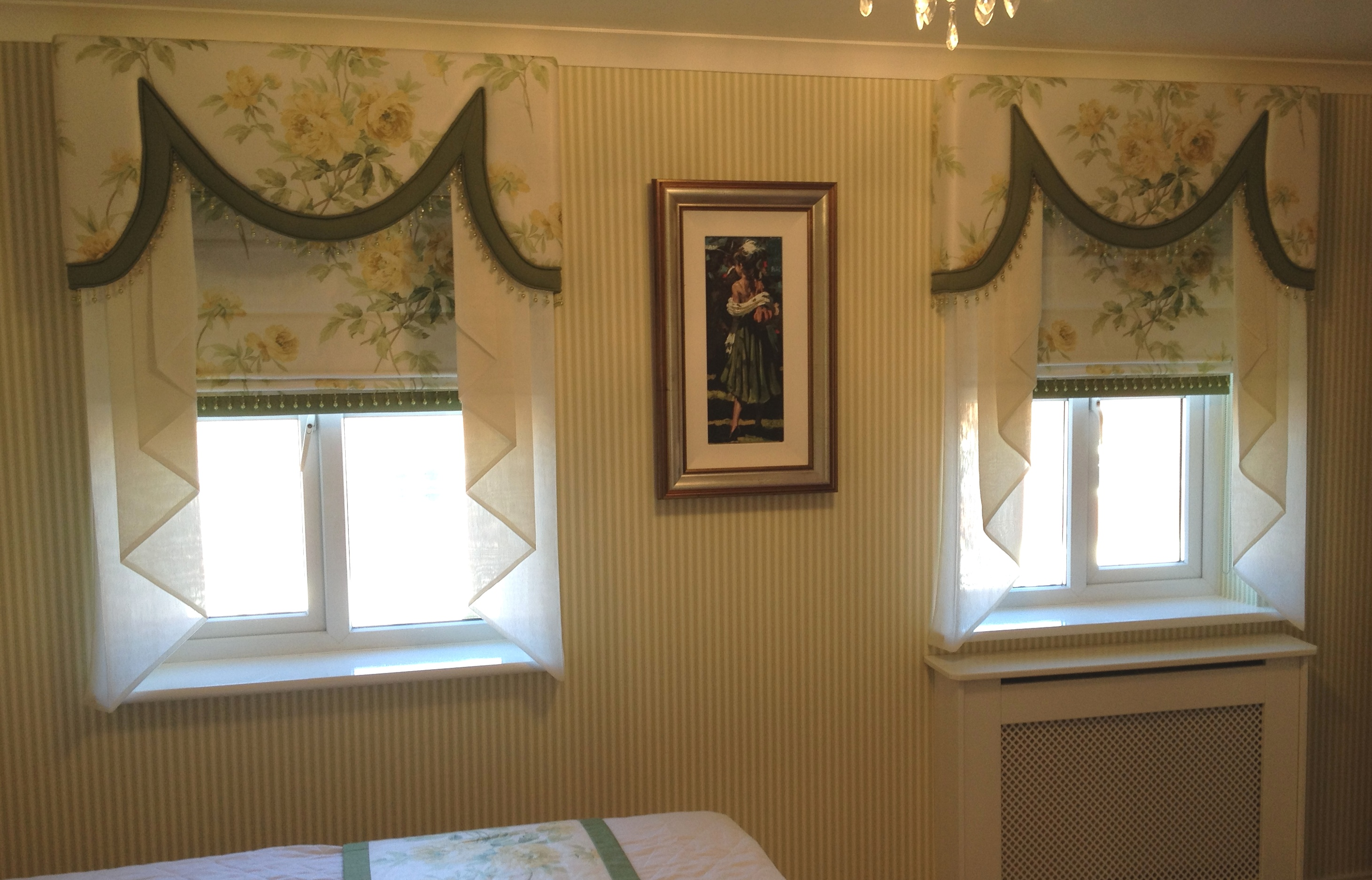 white yellow and green pelmet with matching roman blinds and voile tails