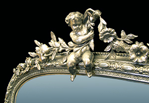 Cherub and urn over mantle mirror in Palladium. Made by Ruth Tappin