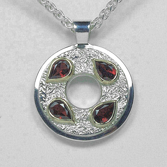 round silver and gold garnet pendant