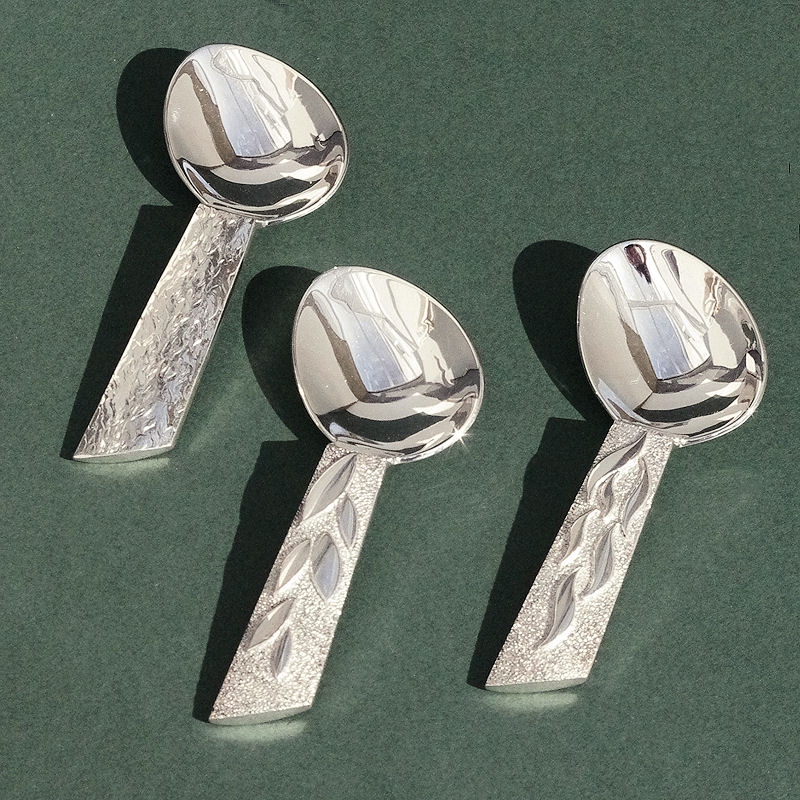 Silver caddy spoons
