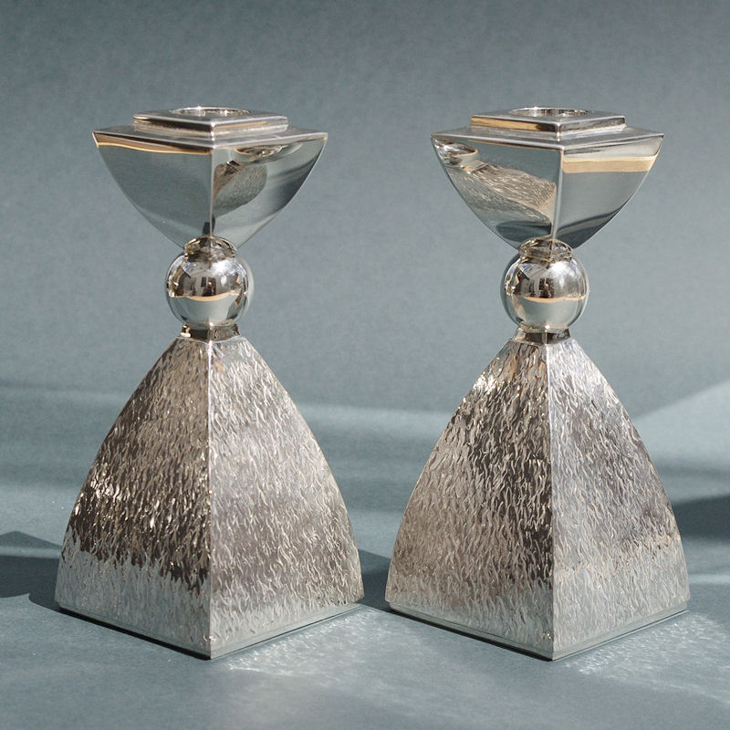textured silver candlesticks