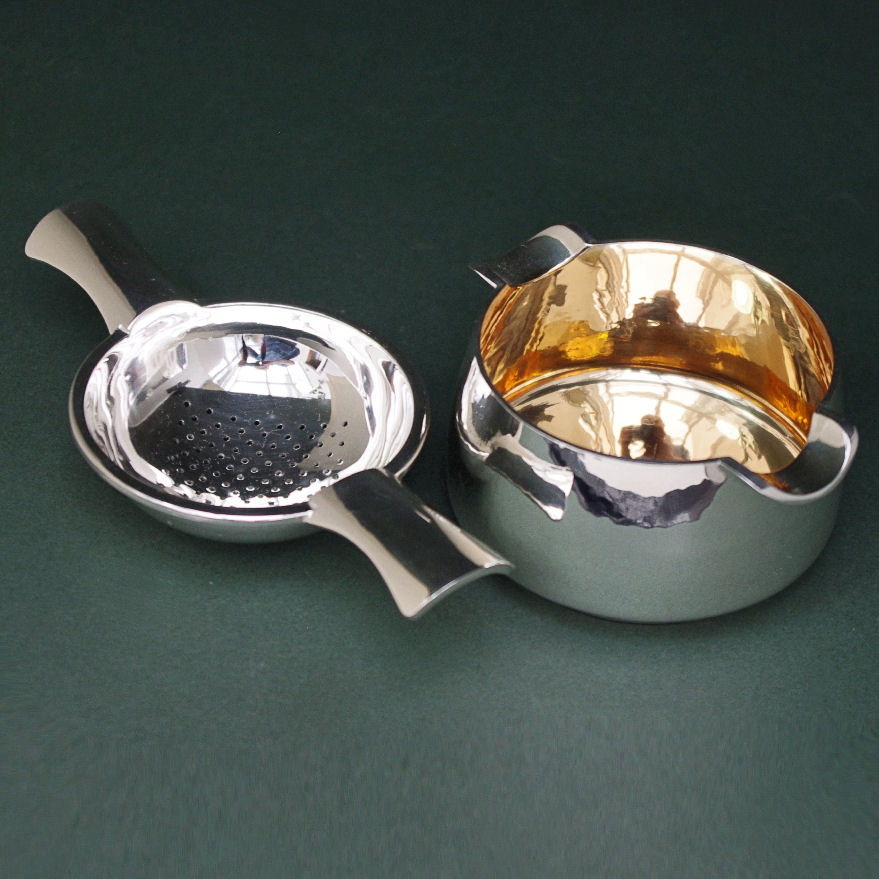 Silver tea strainer and bowl