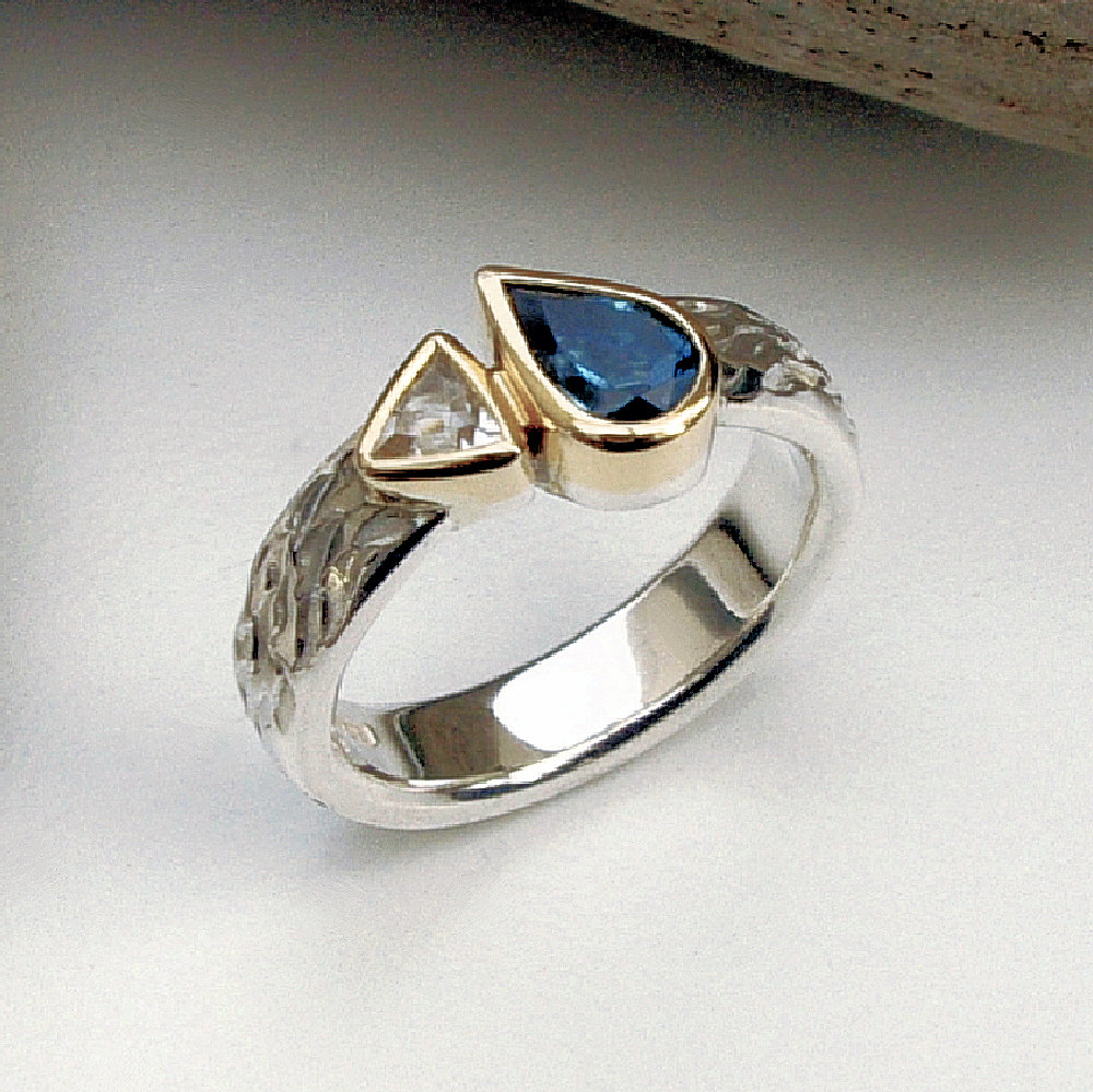 Blue & white topaz ring