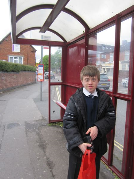 Josh waiting at the bus stop