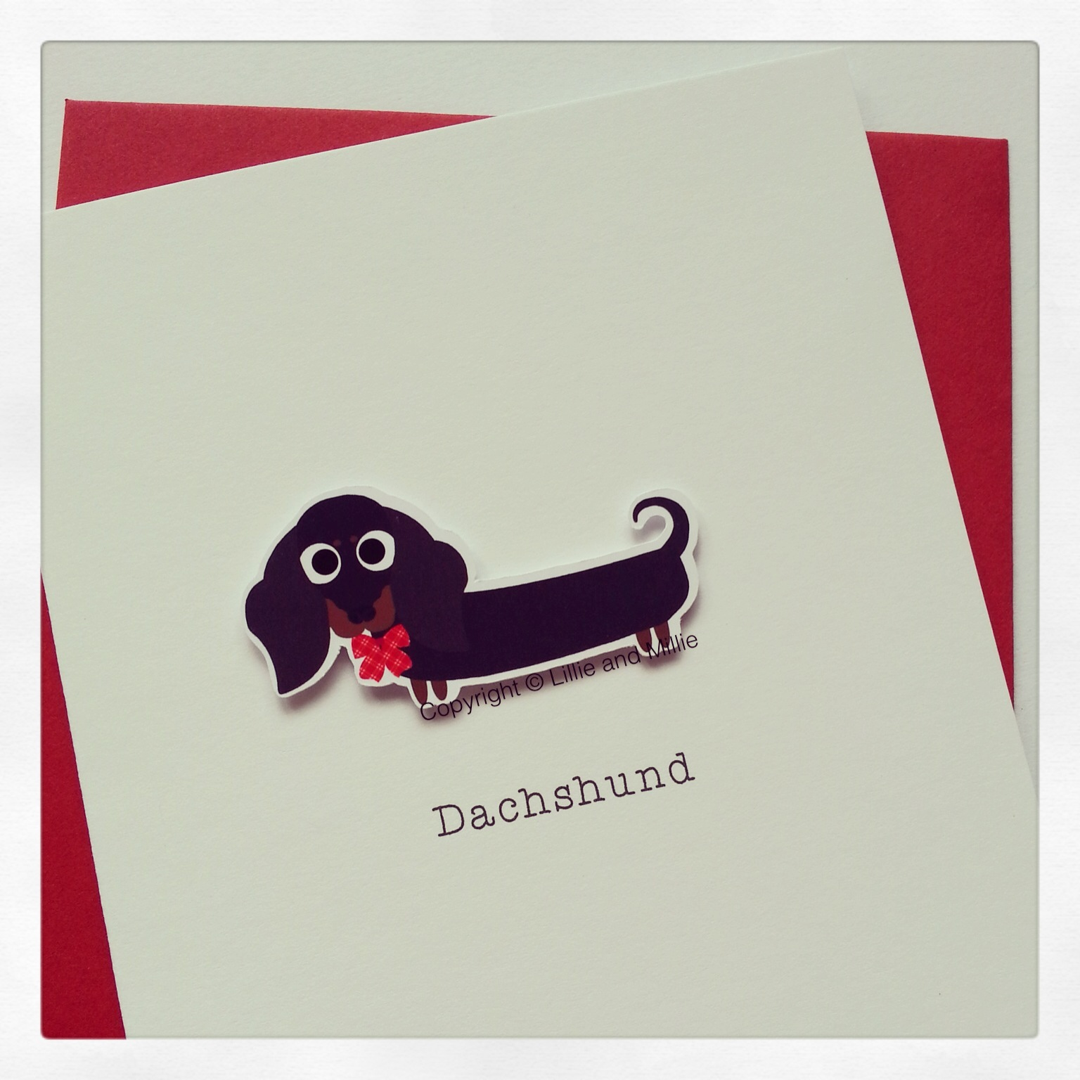Cute and Cuddly Black and Tan Dachshund Greetings Card