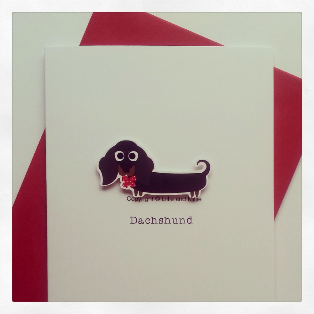 Cute and Cuddly Black and Tan Dachshund Card