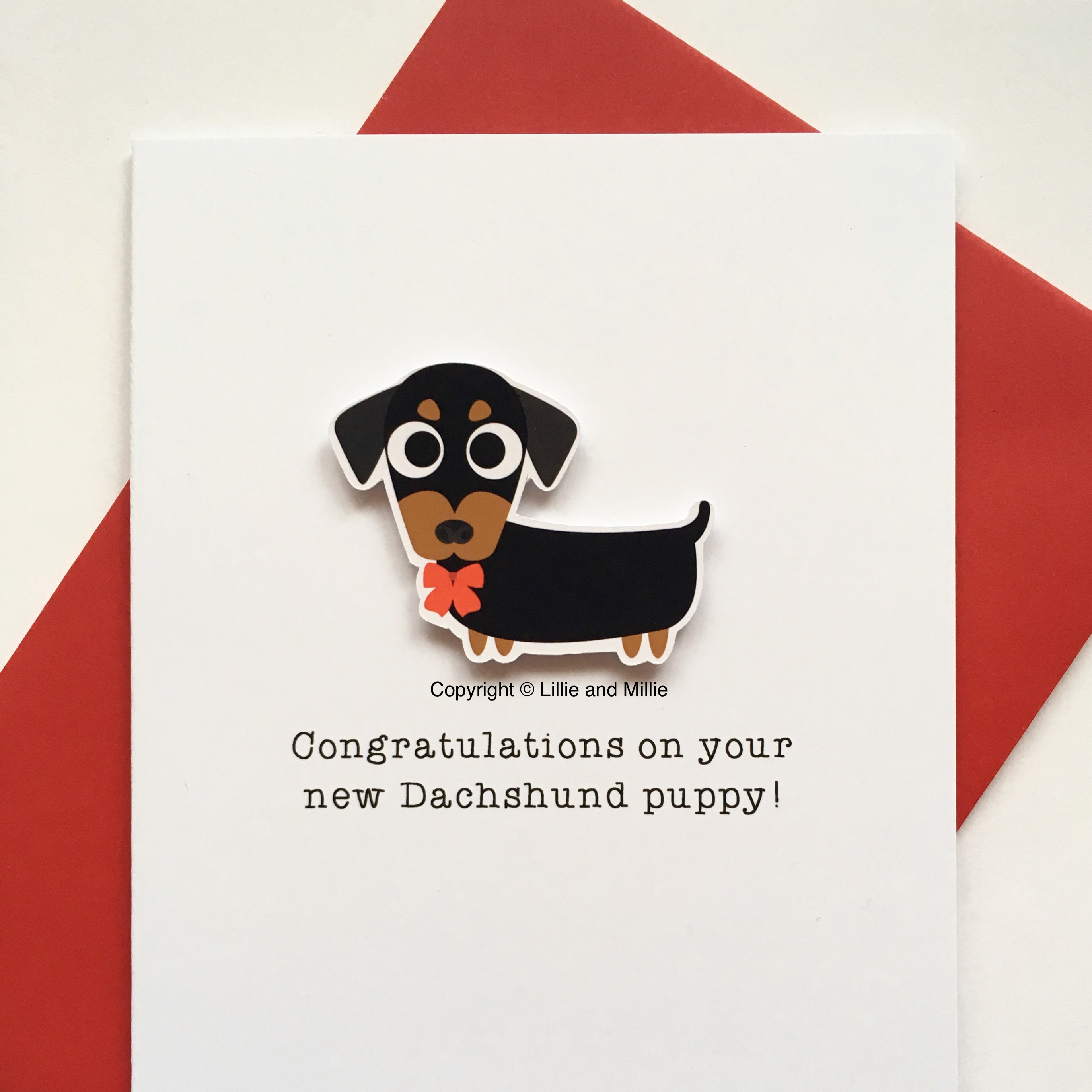 Cute and Cuddly Dachshund Red Bow Congratulations Puppy Card