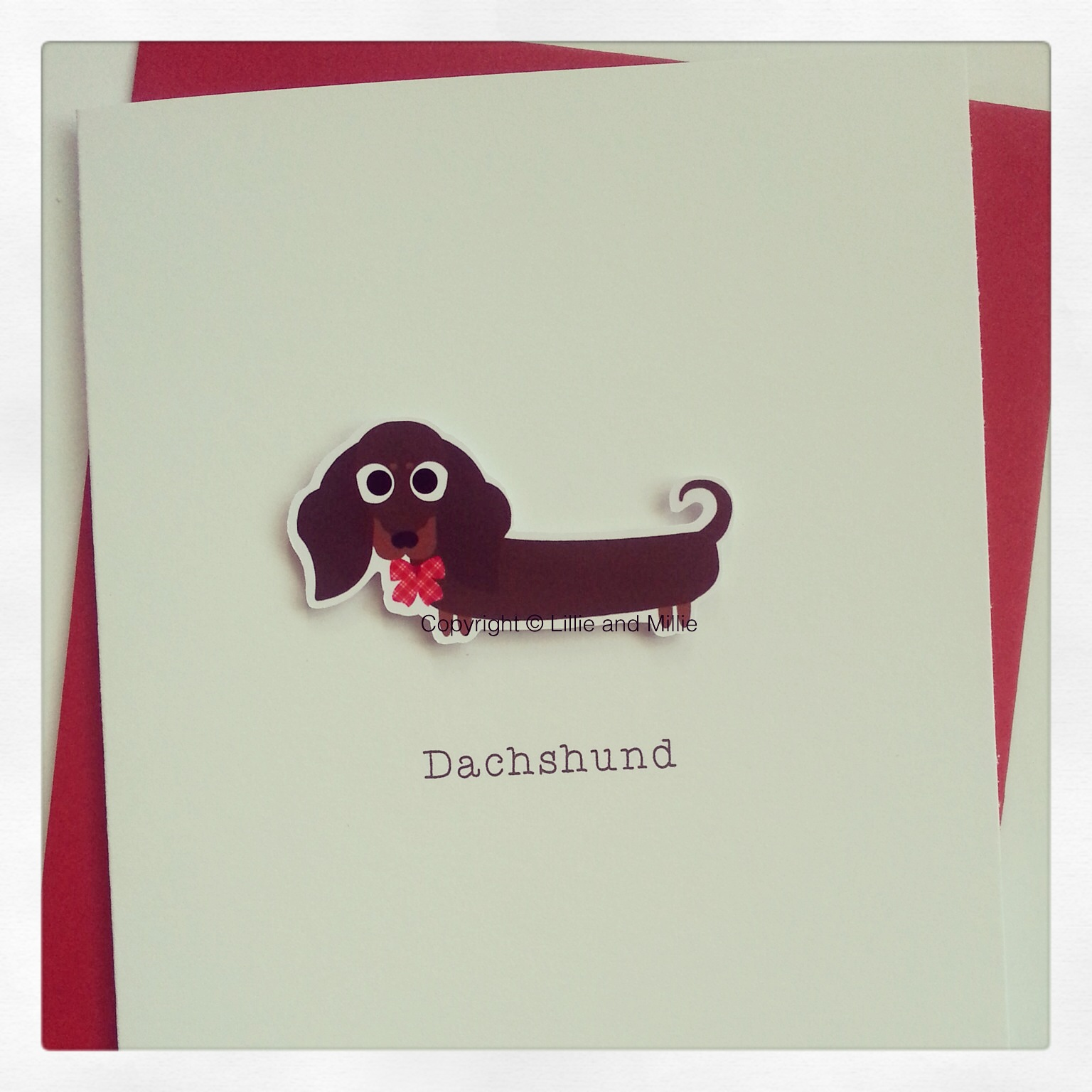 Cute and Cuddly Chocolate and Tan Dachshund Greetings Card