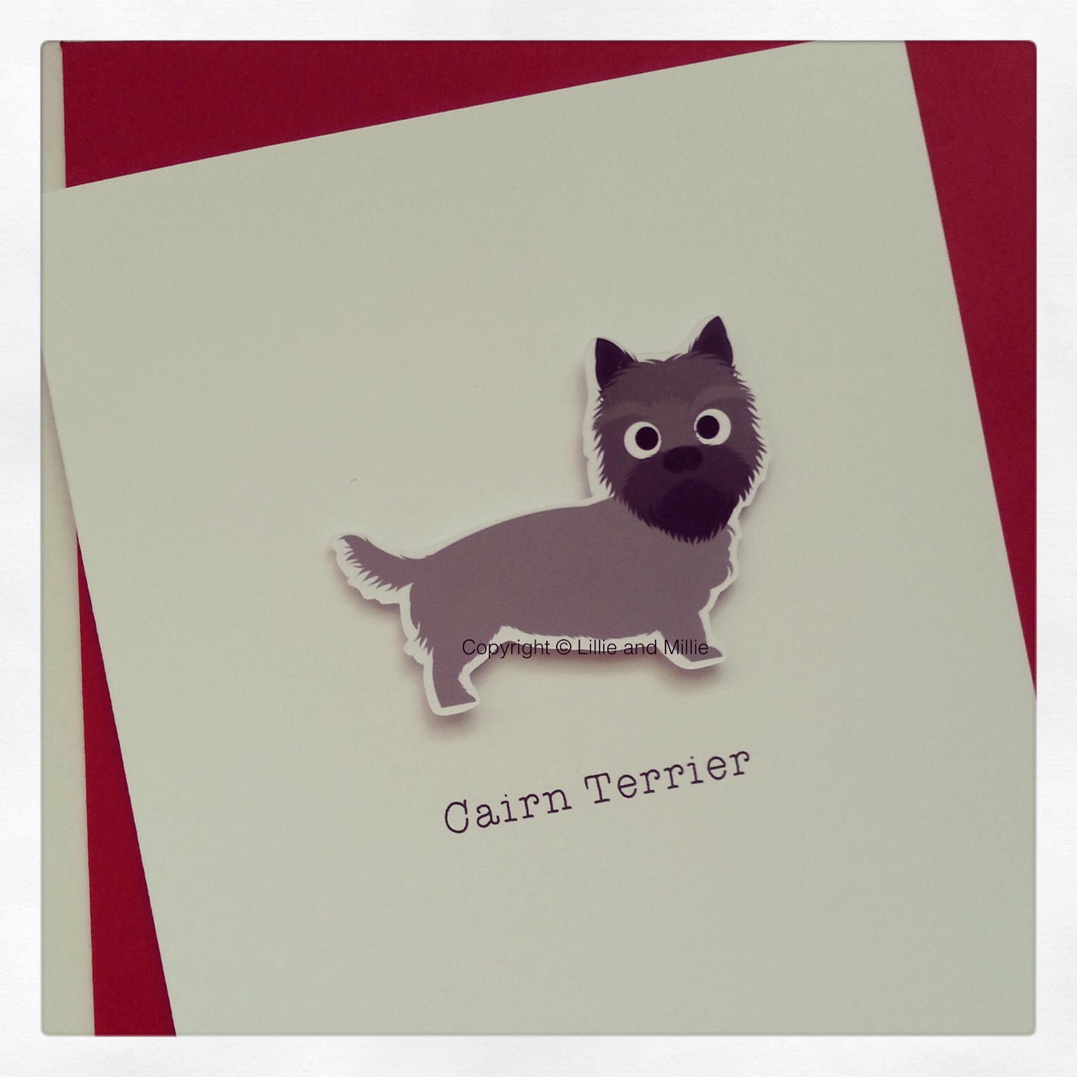 Cute and Cuddly Grey and Black Cairn Terrier Card