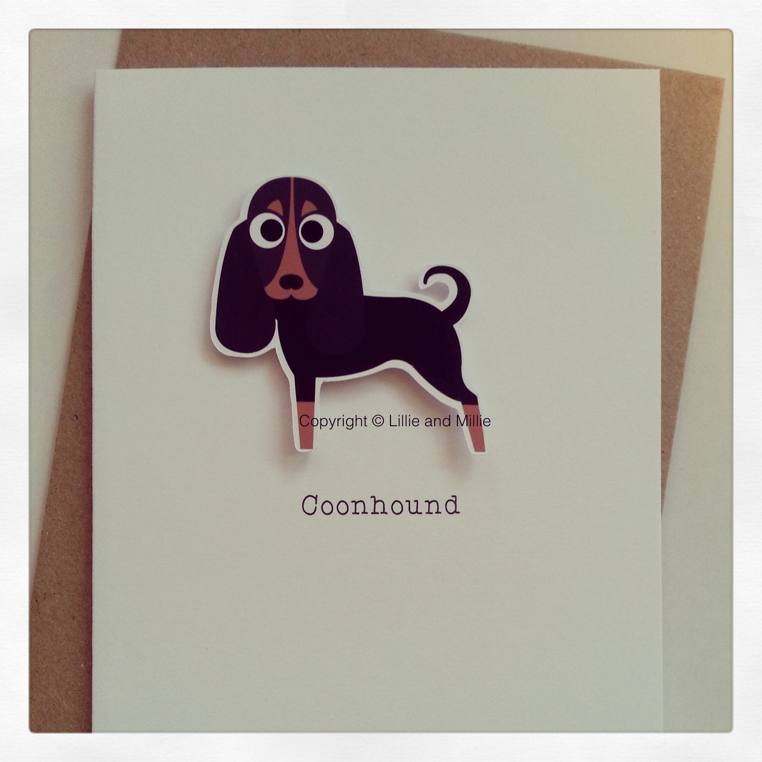 Cute and Cuddly Coonhound Greetings Card